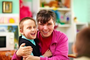 CARE ABA Tutor Working 1:1 with Special Needs Child